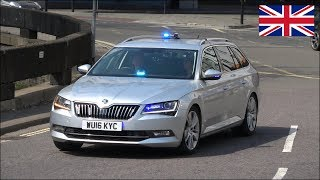 Skoda Superb unmarked police car responding with siren and lights