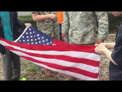 Graham Academy Students Learn How to Handle American flag.