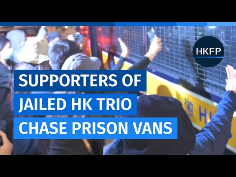 Supporters of Hong Kong's jailed pro-democracy trio chase prisoner vans outside court