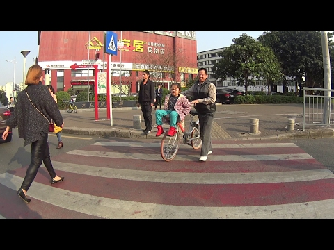 bicycle riding in shenzhen streets - guangdong china - Feb 13 2017