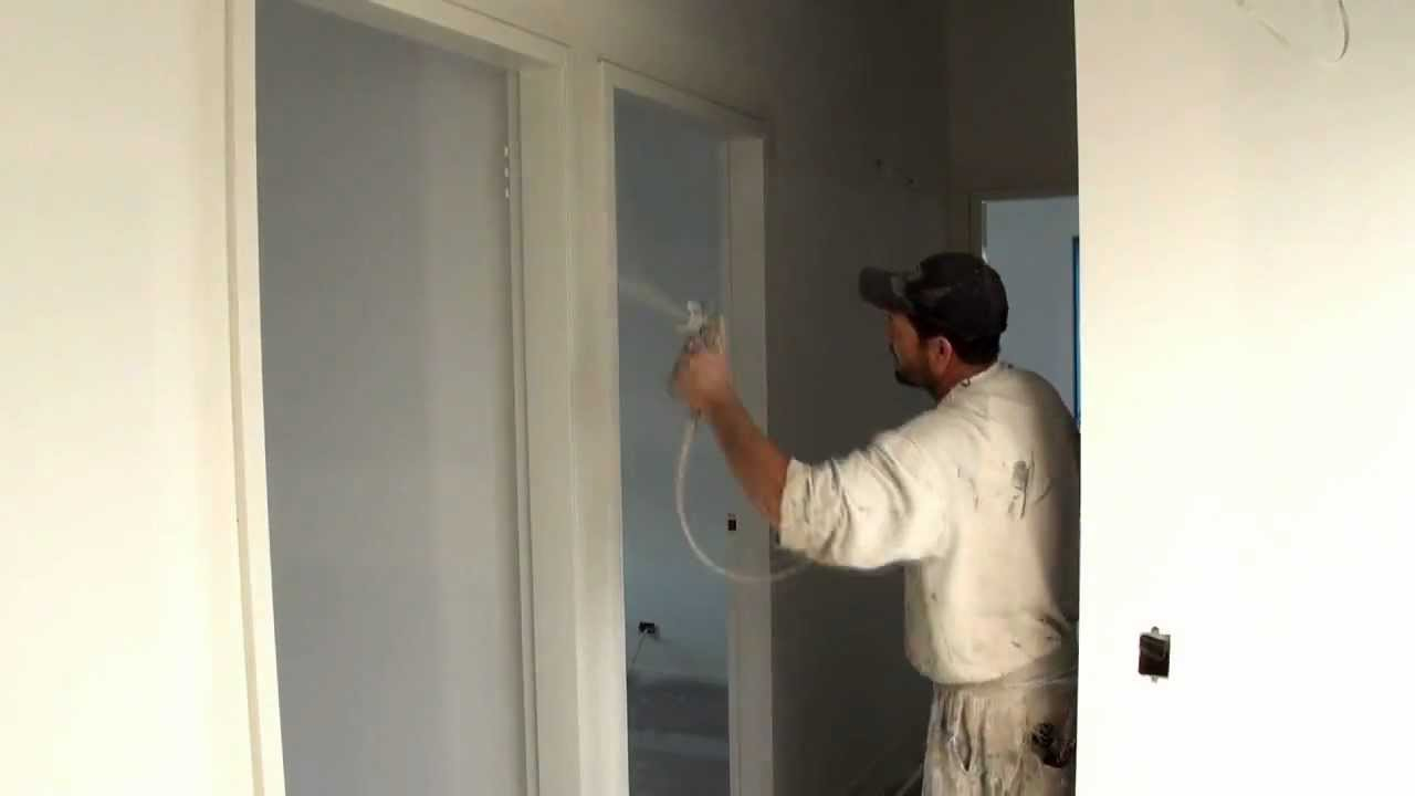 how to paint trim spray painting a door frame using an airless