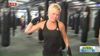 Yup - she's flipping tires again! Fox 8's Tracy McCool at TITLE Boxing Club
