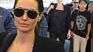 Angelina downplayed her presence in a simple all black ensemble as they arrived at JFK International