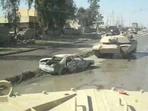 Tank rolls over a bomb