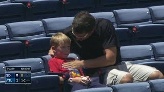 SD@ATL: A fan gets foul ball, celebrates with son