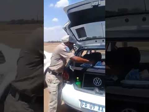 Corrupt Police Officer showing off bribery money in public