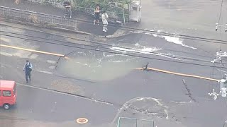 Water Surges Onto Pavement From Furst Pipe Following Japan Earthquak