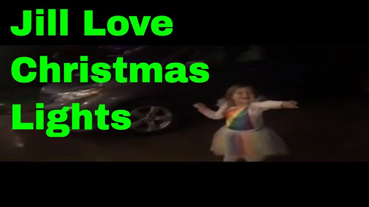 jillian and jena turning on grandmas christmas lights on halloween