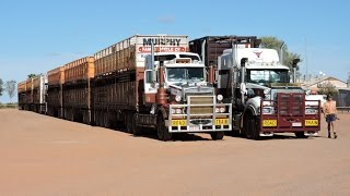 Three Massive Road Trains pulling out onto Stuart Highway Australia.