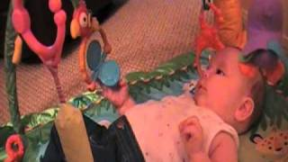 Shelby in her Fisher-Price Rainforest Melodies & Lights Deluxe Gym