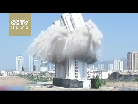 Watching skyscraper demolished with pinpoint precision in Shanxi Province