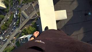 Parkour Runner Misses Jump And Falls Off High Rise Roof, Catches Himself On Electric Wires