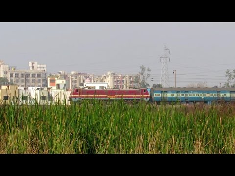 Late running 12834 HWH-ADI Express with SRC WAP-4 in lead