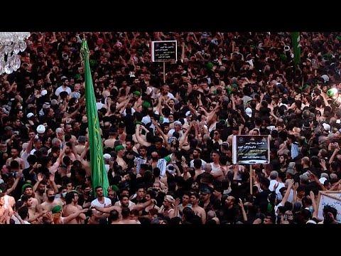 شاهد: الحجاج الشيعة يحيون ذكرى أربعينة الإمام الحسين في كربلاء…