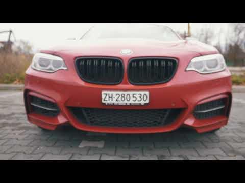 Beautiful girl driving BMW 240i