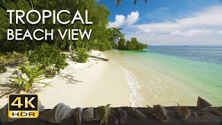 Relax and enjoy the balcony view of a bamboo beach hut, overlooking pristine with clear waters turquoise ocean gently washing white sa...