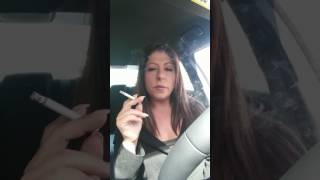 Woman Smoking cigarette, coughing not ashing