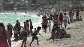 Mexico sees holiday bump in tourism amid pandemic surge