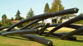 """Warmth: Giant Black Toobs""  by Susan Robb at the Richmond Beach Community Park"