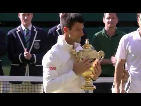 Novak Djokovic receives the Wimbledon trophy - Wimbledon 2014