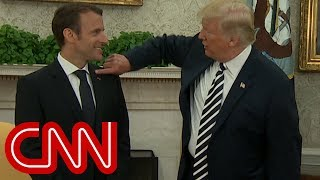 Touchy-feely Trump and Macron