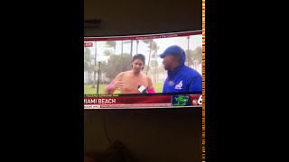 Man performing stunt for hurricane Irma is interviewed by reporter