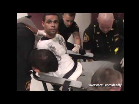 Officers pepper spray detainee in restraints