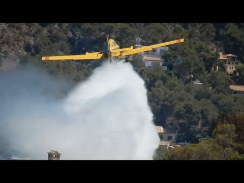 Plane and helicopter putting out a fire
