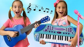Sofia and Papa Pretend Play with toy Musical Instruments