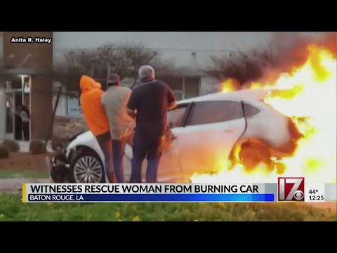Witnesses rescue woman from burning car