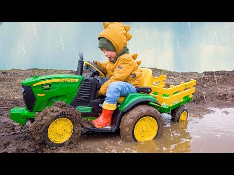 Funny Leo on a Big tractor, escaping from the rain stuck in the mud and lost his cars