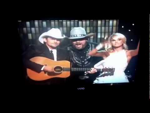 Brad and Carrie at the CMA Awards picking fun at Hank Williams and Tim Mcgraw and Faith Hill Barbies