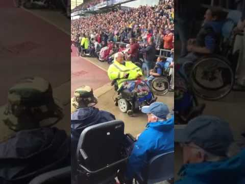 Man in Motorized Wheelchair Does Spins To Crowd's Applause
