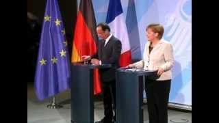 Молния не помешала встрече Олланда и Меркель