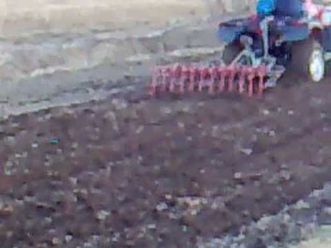 Atv spring cultivator at work YouTube