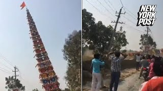100-foot tower falls directly onto power lines | New York Post