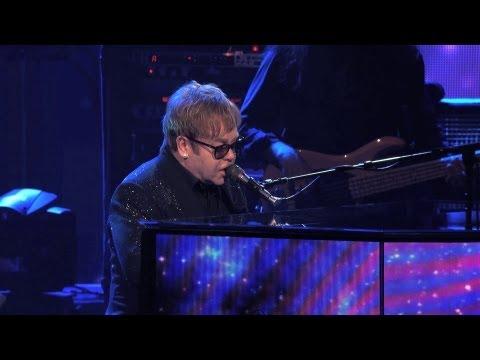 Sir Elton John greets the