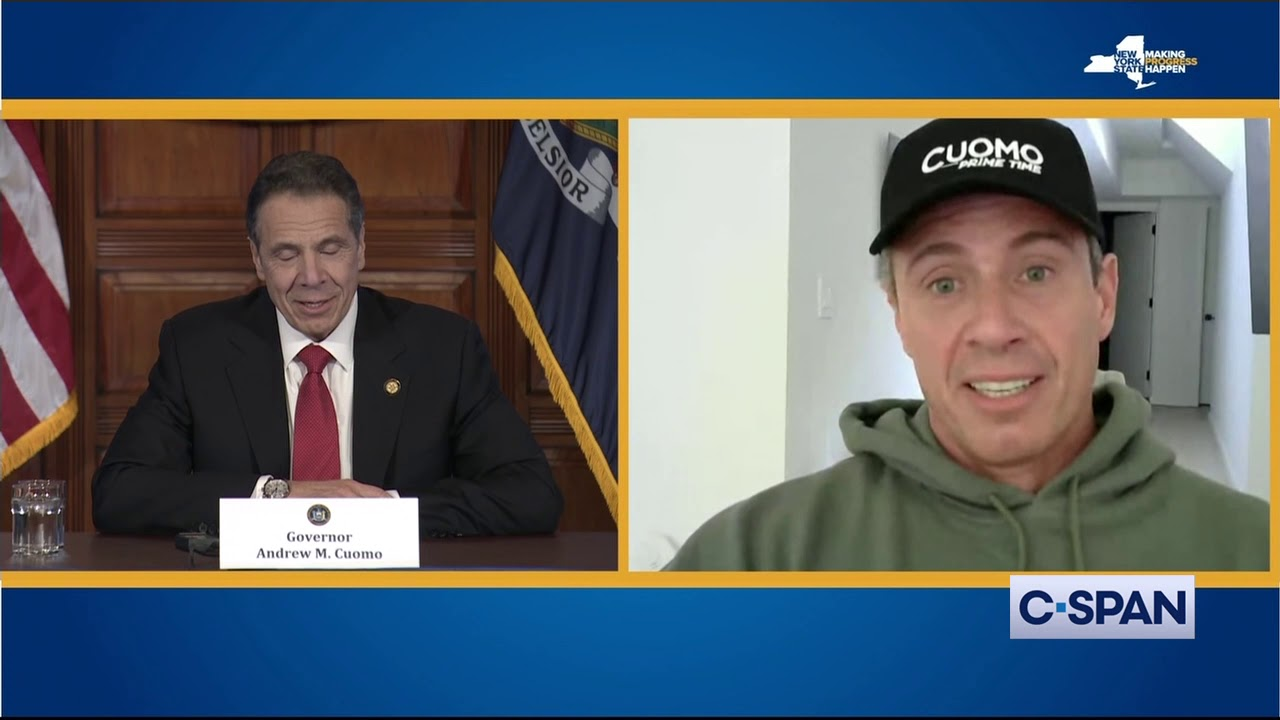 Governor Andrew Cuomo talks to his brother Chris Cuomo