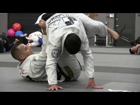 Leka Vieira rolling with Checkmat founder Leo Vieira after being promoted to 5th Degree black belt