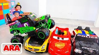 يركب فلاد ونيكيتا على شاحنة لعبة الوحش ويمر عبر سيارات للأطفال