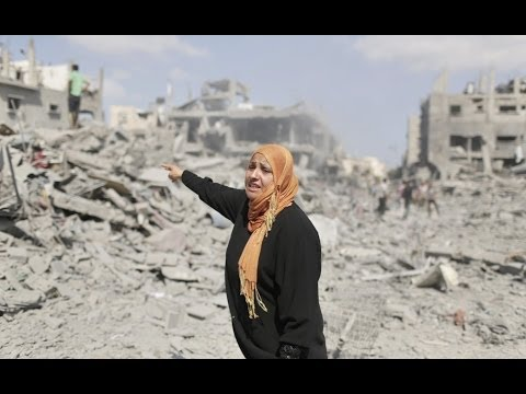 During cease-fire, Gaza residents survey destruction - PBS NewsHour  - aalCwwX2xjo -