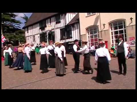 Norwich Historical Dance perform the dance'Haste to the Wedding' in Diss market place. June 2014