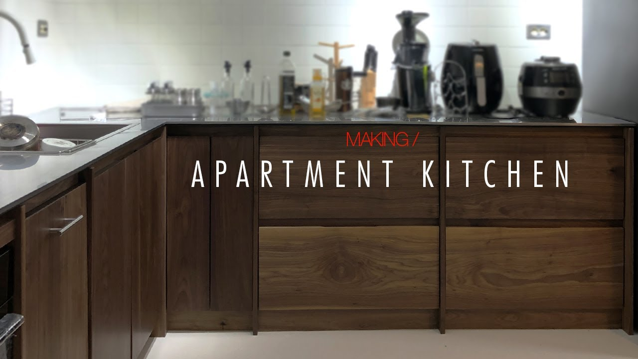 W106_Apartment small Kitchen with walnut and stainless steel