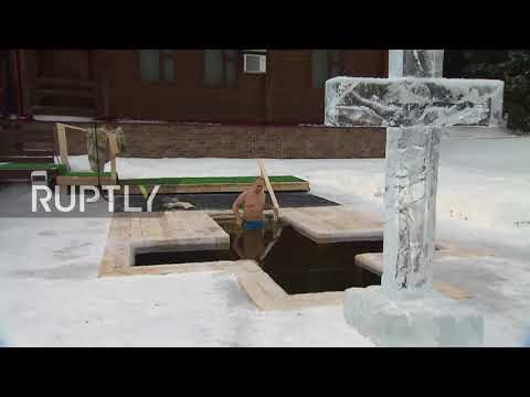 Russia: Putin takes plunge in icy waters to mark Orthodox Epiphany