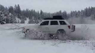 jeep wk grand cherokee hemi 8 inch lift on 35 s hooning in the snow