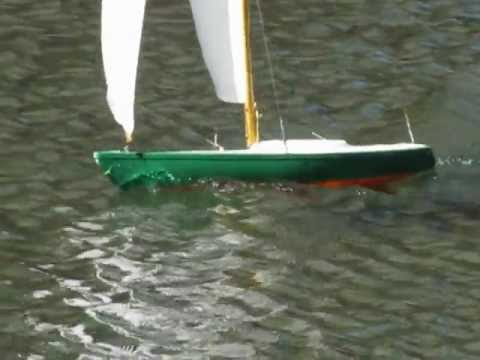 Screaming fast R/C Soling one meter sailboat model on Christian Science  pool Boston