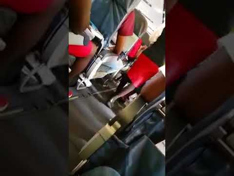 Delirious Lady on a Cayman Airways Flight to Kingston..