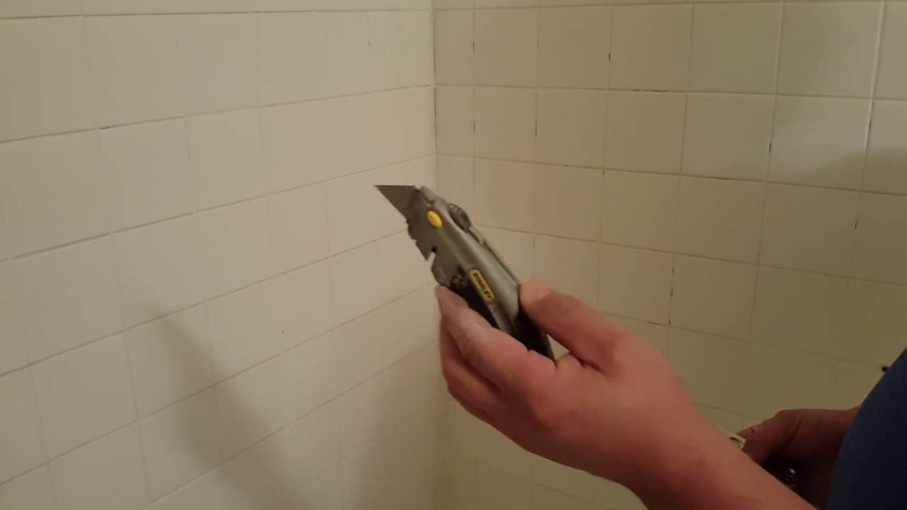 Bathroom Grout Removal And Application Of New Grout