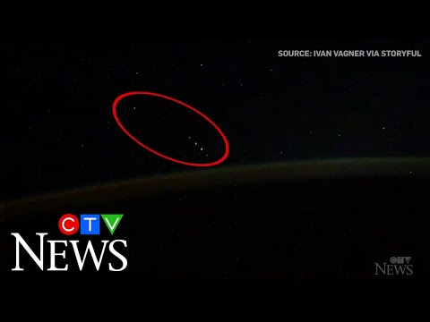 Cosmonaut sees UFOs while filming the Aurora Borealis