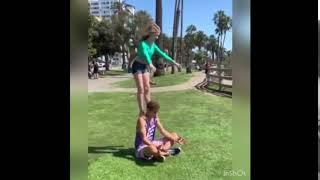 Elliana Walmsley does a back flip off someone's shoulders!